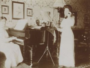 Teresa playing the piano accompanied by her sister Gioconda on the violin.