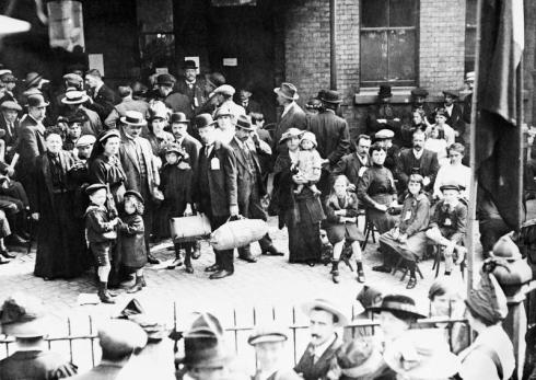Belgian refugees outside Hudsons Furniture Repository, Victoria Station, London, September 1914. © IWM (Q 53305)