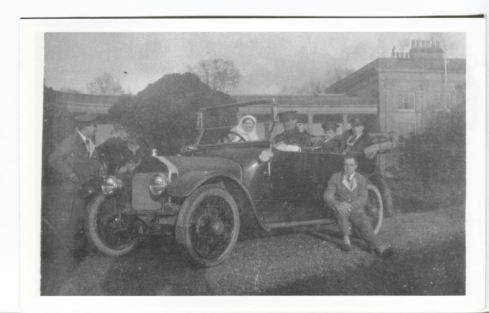 Wounded soldiers and nurses in a car at Attingham Park during WWI