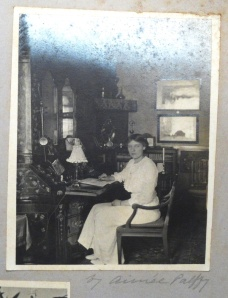 Teresa Hulton at a writing desk in her family home in Venice, 1913.