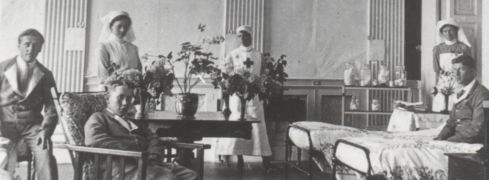 Nurses and wounded soldiers in the Outer Library at Attingham Park during WWI