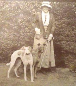 Teresa with two dogs, Potten, England, 1915.