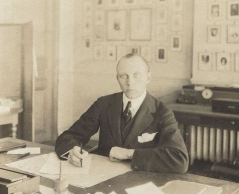 Lord Berwick at a desk taken between 1900 and 1919.