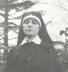 Photograph of Teresa Hulton in a blue silk Red Cross headdress