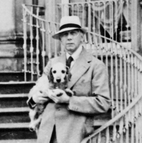 Lord Berwick and his dog on the Portico steps at Attingham, 1938.